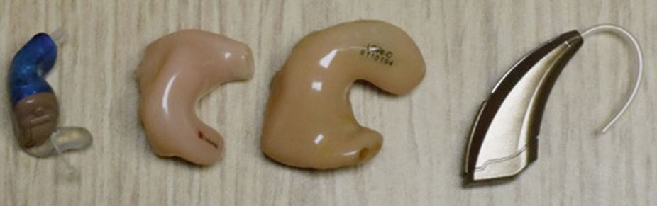 tinnitus treatment - picture of 4 different hearing aids